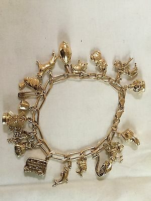 9ct Gold Charm Braclet With 19 Charms