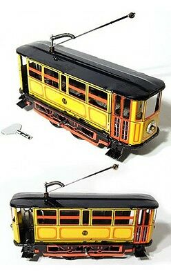 Yellow, Red, Black Electric Trolley Tin Litho Wind up Clockwork Mechanism