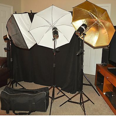 Three strobe light kit w/carrying bag, 2 umbrellas, 2 soft boxes, 3 stands