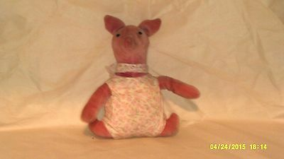 A Vintage Stuffed Piglet Stuffed Doll
