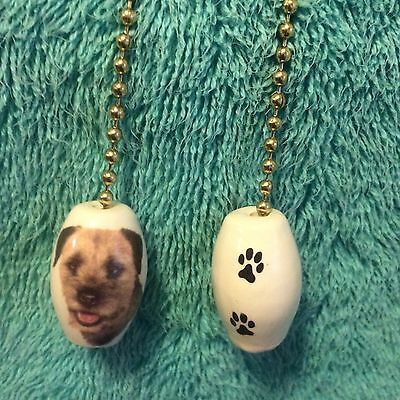 One Border Terrier  Dog Fan Pull With Paw Prints On The Back 1-inch