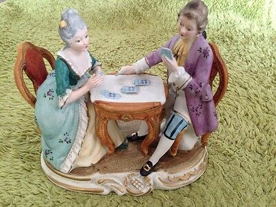Vintage Figurine of Gentleman and Lady Playing Cards