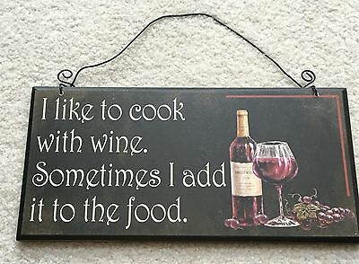 "Wine Sign I like to cook with wine. Sometimes I add it to the food. 12""x6"" Wood"