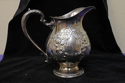Frank M. Whiting & Co. Sterling Silver Repousse Style Water Pitcher