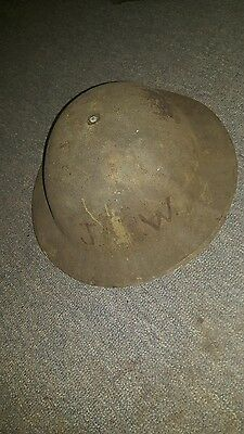 ww1 doughboy helmet marked with standing liberty 77th division JW initials