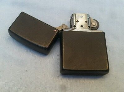 Zippo Plain  Black Lighter.  Used Condition With A Few Surface Marks See Descrip