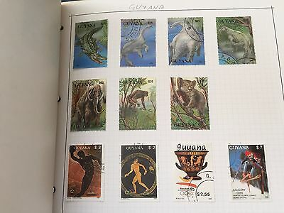 Caribbean and Latin american country stamps in album on pages nice