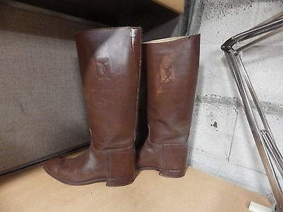 Pair of vintage antique leather horse riding boots nice for age criss cross