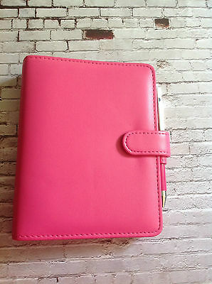 small pink filofax organiser with pen