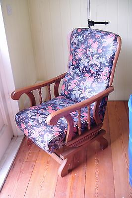 NURSING CHAIR IN GOOD CONDITION. Easy wipe fabric. Multi coloured. Slight rock.