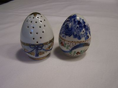 Lovely porcelain egg shaped salt and pepper shakers with screw on bottoms