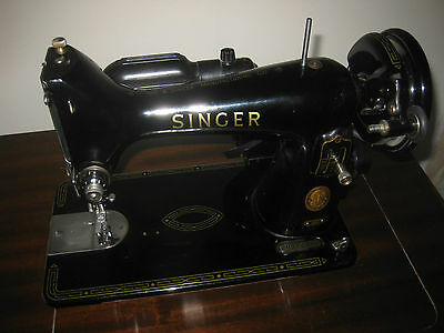 Singer sewing machine in table, working, purchased 1959, with attachments