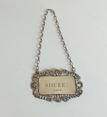 "ORNATE STERLING SILVER EMBOSSED ""SHERRY"" LIQUOR BOTTLE LABEL, 10 grams"
