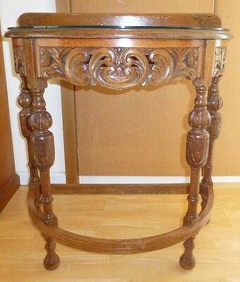 hallway table ornately carved glass top