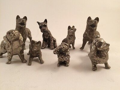 Collection of 8 Metal Dog Figures Spaniels, Terriers, German Shepherd & More