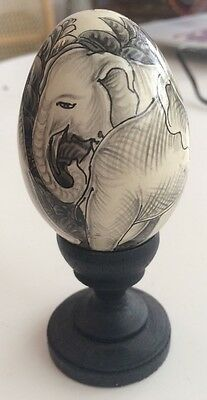 Hand painted egg on wooden stand