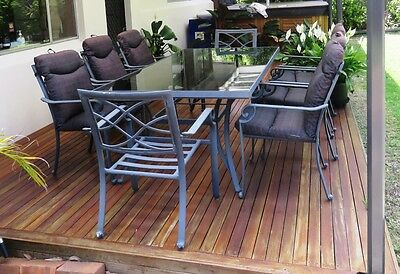 Large outdoor setting 9 piece metal table with glass top and metal chairs