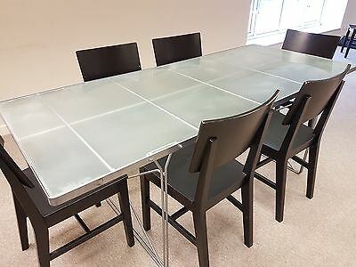 Office meeting Table with glass top, plus 6 black wooden chairs