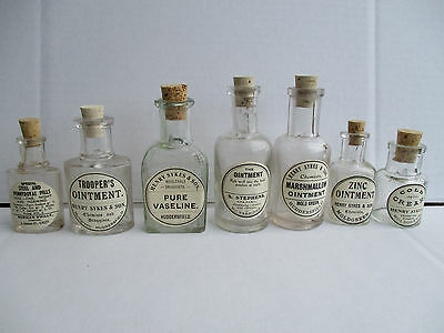 7 small old bottles with old labels corks kitchenalia bathroom wedding favour