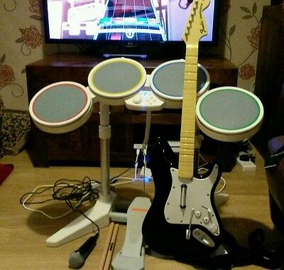 Rockband Bundle for Nintendo  wii Drums/Guitar and 3 games.