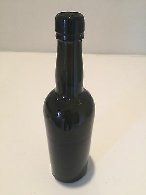 Antique Black Glass Ale Bottle