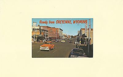 Postcard of Main St. Cheyenne, Wyoming with 1950's Cars and Trucks