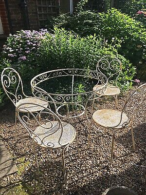 Pretty Wrought Iron Garden Table And Chairs