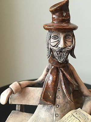 Ceramic Figurine Of Old Man On Bench
