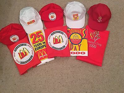 A Collection of McDonalds Commemorative Aprons and Caps