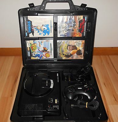 Sega Megadrive in case with games and controller