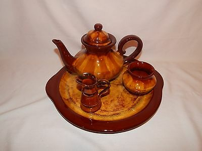 Blue Mountain Pottery harvest gold tea pot, tray and sugar bowl.