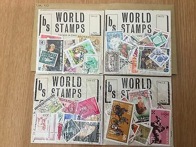 4 packets of world stamps