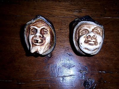 Original pair of wall candlesticks depicting 2 faces of men of the Middle Ages