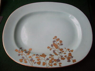 Minton p/green plate raised giulding in gold and silver,stamped,h/signed G5056S