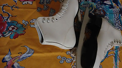 As new white leather ice skate roller blades. Size 2
