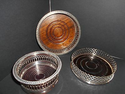 3 vintage silver plate wine coasters with turned wooden bases