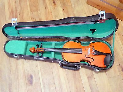 A Skylark Brand 1/4 violin with carrying case