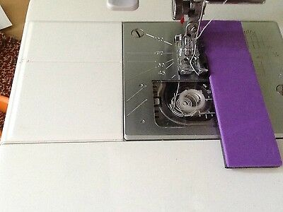 Magnetic sewing machine attachment  for straight seams