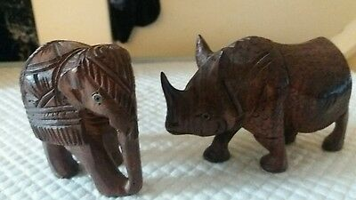 wooden carved rhino and Elephant