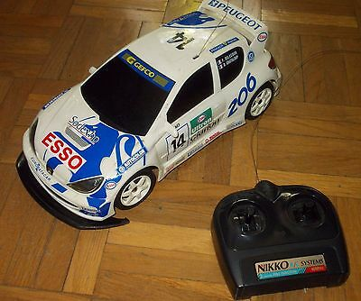 Nikko Peugeot 206 WRC Rally car; Drift , 1/16 . Tested and works!