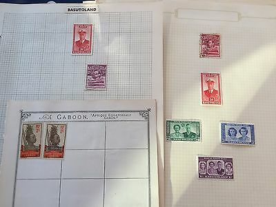 Mauritius +  Basutoland assortment of stamps from multiple collectors on pages