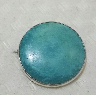 Large circular turquoise Ruskin brooch mounted in sterling silver