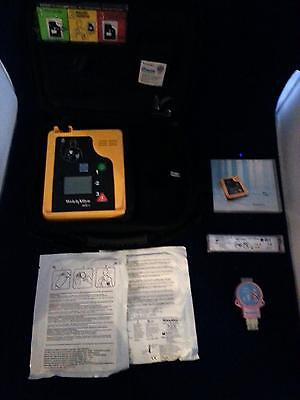 Welch Allyn AED 10 with New Battery, 2 sets of Pads, Pediatric Reducer, & Case