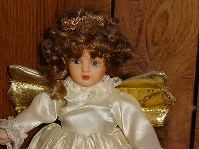 """Angel doll 9 3/4"""" tall w/metal doll stand, porcelain like body except torseau ?"""