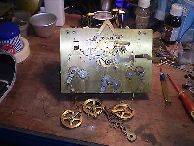 A large used Hermle triple chime clock movement with hands.