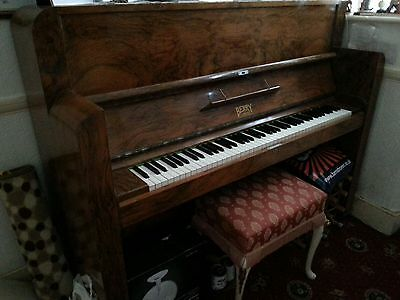 A used but in good condition Berry London piano