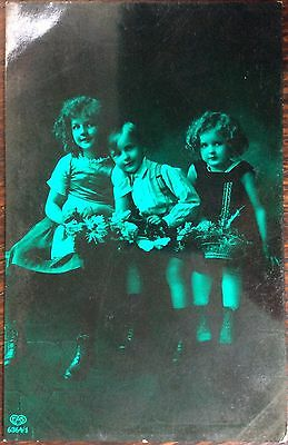 Antique Novelty Rppc View Of Three Smiling Children Holding Flowers Green Finish