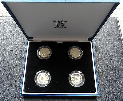 2003  'silver Proof'  Set Of Four Pattern  £1  (Pound) Coins.. Cased With Coa