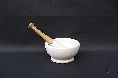 Pestle and Mortar in stoneware with wooden handle used