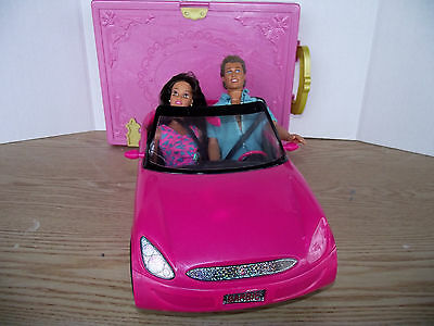 Barbie doll and and ken car